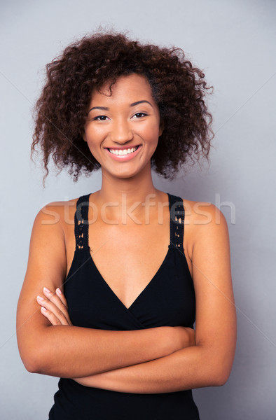 Woman standing with arms folded  Stock photo © deandrobot