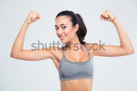 Happy elegant woman showing her biceps Stock photo © deandrobot