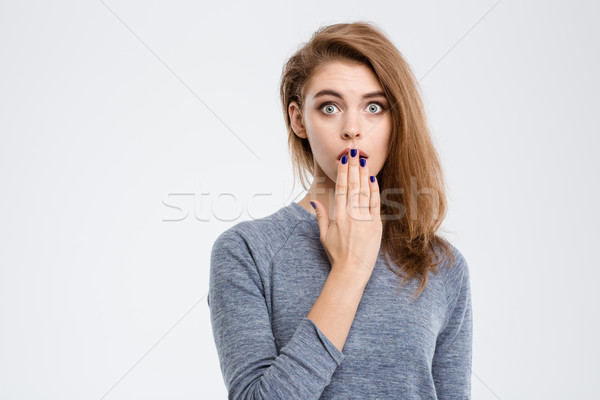 Amazed woman covering her mouth with palm  Stock photo © deandrobot