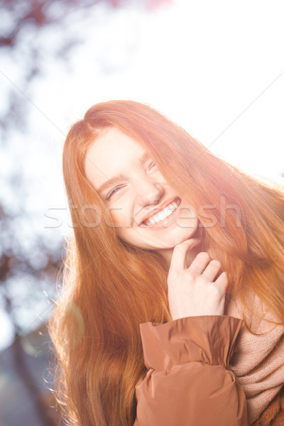 Funny redhead woman looking at camera Stock photo © deandrobot
