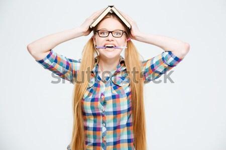 Upset female student holding books Stock photo © deandrobot