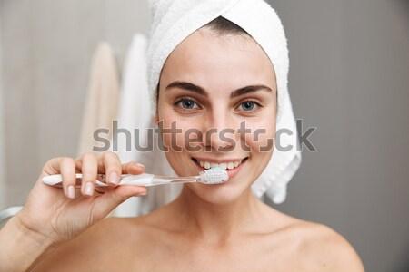 Conteúdo mulher creme dental escova de dentes beleza Foto stock © deandrobot