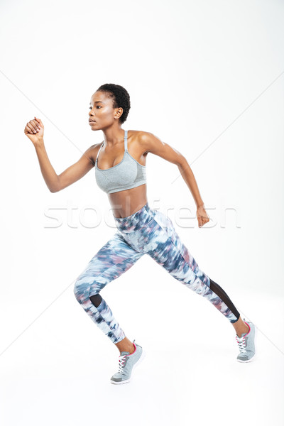 Concentrated beautiful young african american sportswoman running  Stock photo © deandrobot