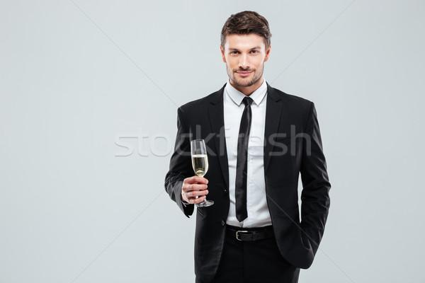 Hombre traje empate vidrio champán Foto stock © deandrobot