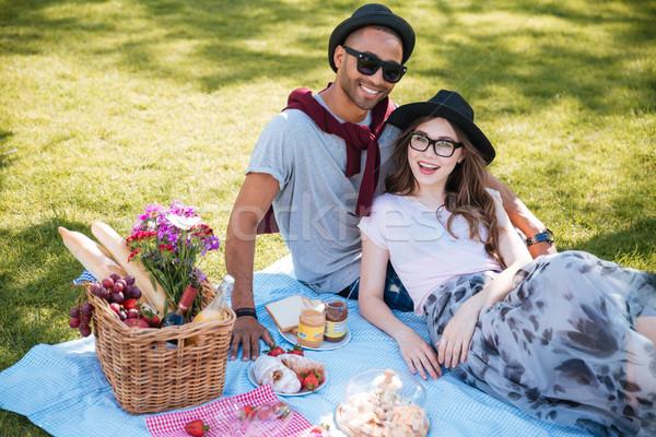 Sorridere picnic prato parco ritratto Foto d'archivio © deandrobot