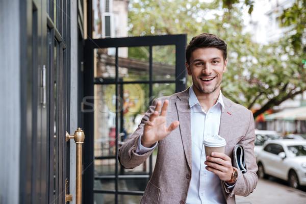 Biznesmen pitnej kubek kawy ktoś Zdjęcia stock © deandrobot