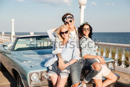 Stock photo: Cheerful young couple dancing outdoors and having fun