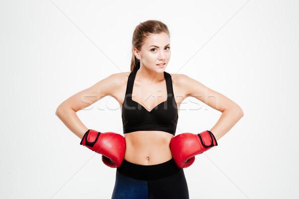 Sorridente mulher da aptidão luvas de boxe branco mulher feliz Foto stock © deandrobot