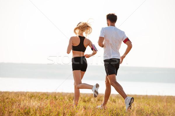 Achteraanzicht jonge fitness man vrouw jogging Stockfoto © deandrobot