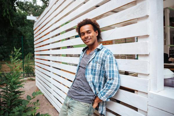 幸せ ハンサム アフリカ 若い男 立って 屋外 ストックフォト © deandrobot