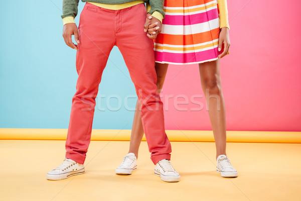 Gambe luminoso vestiti piedi insieme Foto d'archivio © deandrobot