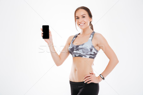 Aerobic woman showing phone Stock photo © deandrobot