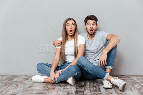 Fashion portrait of astonished couple Stock photo © deandrobot