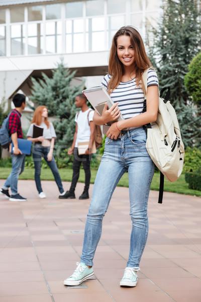 çekici genç kadın öğrenci sırt çantası ayakta Stok fotoğraf © deandrobot