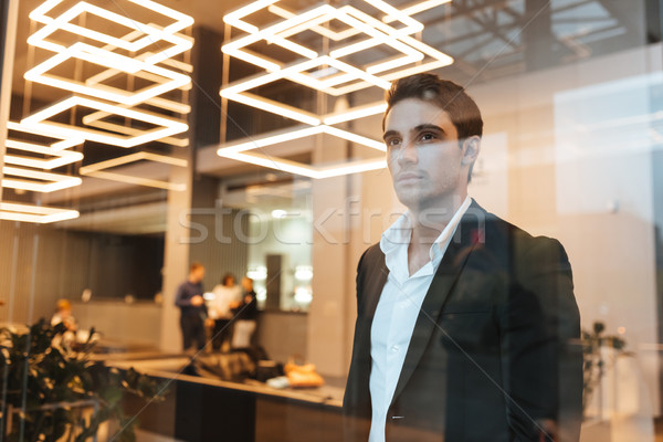 Stock photo: Business man behind the glass