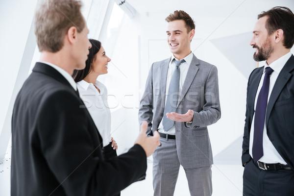 Business people talk near the window Stock photo © deandrobot