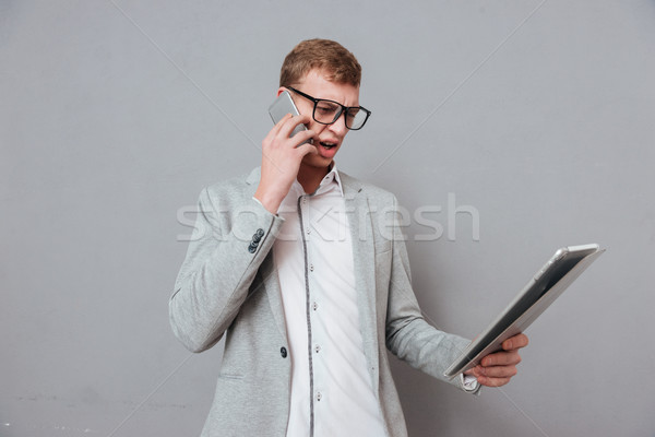 Hipster with tablet and phone Stock photo © deandrobot