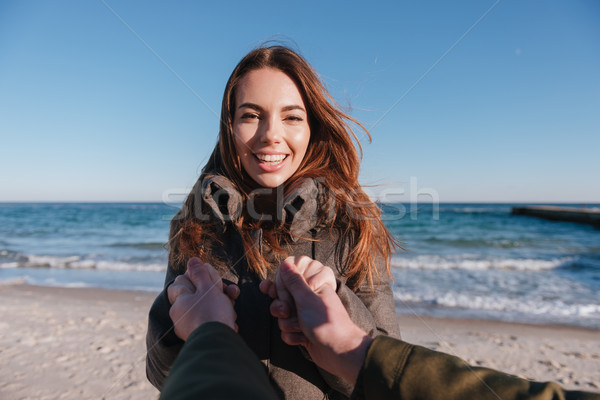 First person view man holding hand of woman Stock photo © deandrobot