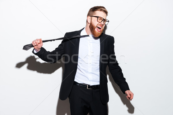 business man pulls his tie Stock photo © deandrobot