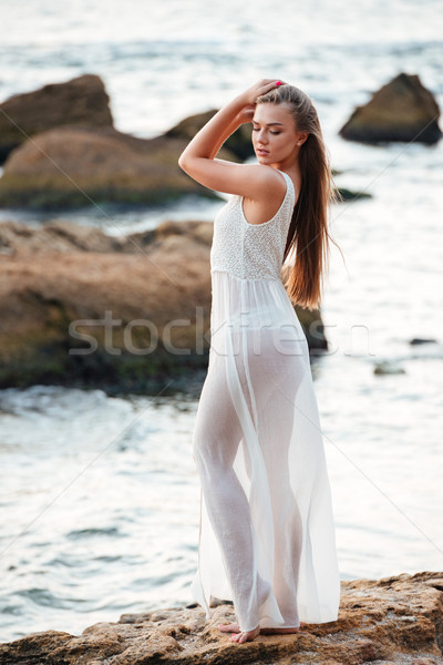 Full length pretty model on the beach Stock photo © deandrobot