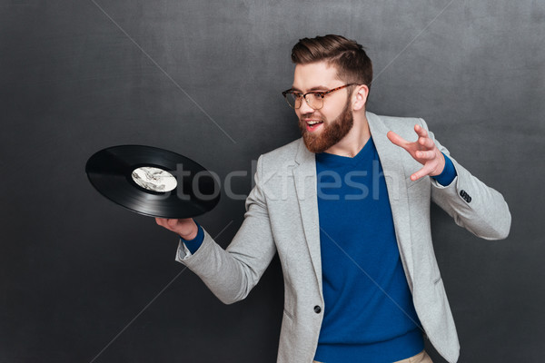 Hipster with vynil Stock photo © deandrobot