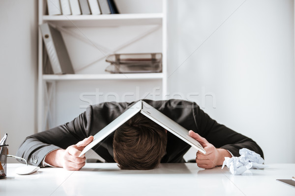 Fiatal fáradt üzletember hazugságok asztal laptop Stock fotó © deandrobot