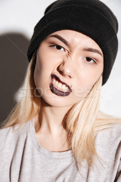 Vertical image of Young Hipster woman in black hat Stock photo © deandrobot