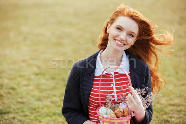 Lány hosszú haj tart húsvét piknikkosár portré Stock fotó © deandrobot