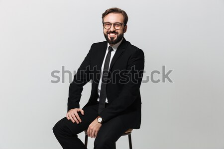 Businessman holding purse full of money. Stock photo © deandrobot