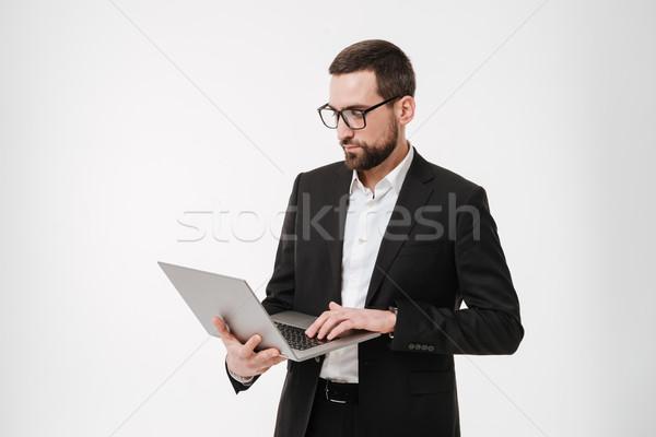 концентрированный бизнесмен используя ноутбук компьютер фотография молодые Сток-фото © deandrobot