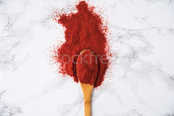 Top view of a wooden spoon with paprika powder Stock photo © deandrobot