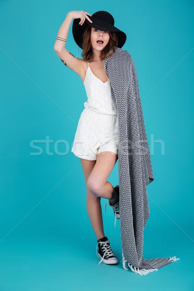 Smiling summer girl wearing hat and blanket ovr her shoulder Stock photo © deandrobot