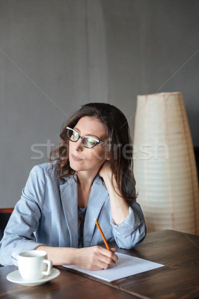 Kadın yazar oturma görüntü Stok fotoğraf © deandrobot