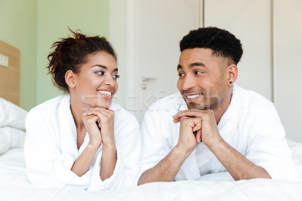 улыбаясь молодые африканских любящий пару Ложь Сток-фото © deandrobot