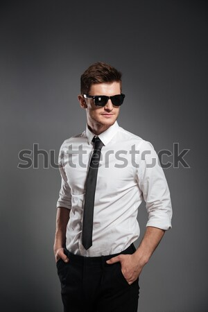 Serious young man dressed in formalwear Stock photo © deandrobot