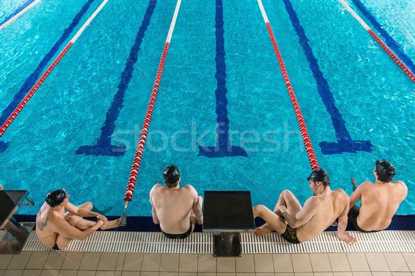 Top мнение четыре мужчины сидят край Сток-фото © deandrobot
