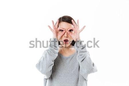 Młodych pani ręce twarz jak okulary Zdjęcia stock © deandrobot