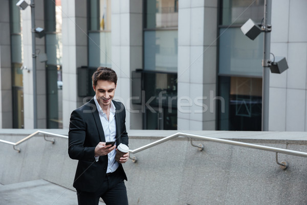 Man using phone and drinking coffee Stock photo © deandrobot