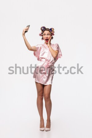 Full length portrait of a laughing crazy blonde woman Stock photo © deandrobot