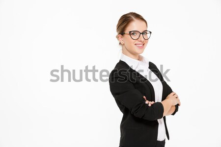 Cool blonde business woman in eyeglasses posing in studio Stock photo © deandrobot