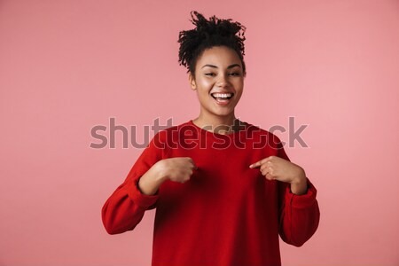 Frustrated young brunette woman in red knitted sweater with hand Stock photo © deandrobot