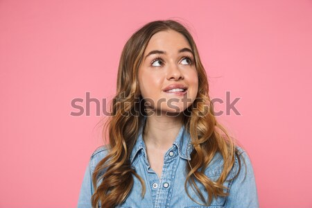 Young lady blowing bubble gum isolated over pink Stock photo © deandrobot