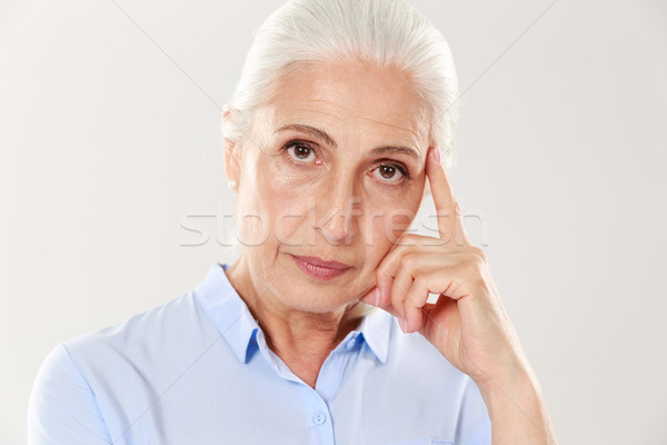 Close-up view of thinking old lady Stock photo © deandrobot