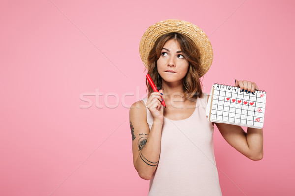 Portrait of a pensive young girl in summer hat Stock photo © deandrobot