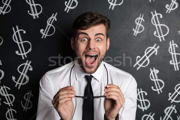 Close-up photo of amazed brunette man takes off his glasses, loo Stock photo © deandrobot