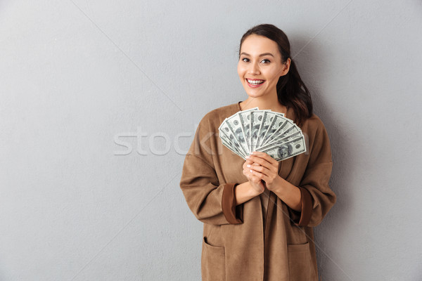 Portrait of a happy young asian woman Stock photo © deandrobot