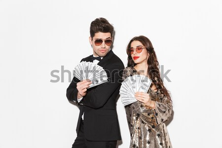Playful punk couple posing with fake mustache, lips and eyeglasses Stock photo © deandrobot