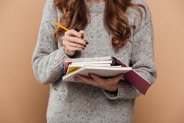 Foto Brünette weiblichen Studenten Wolle Pullover Stock foto © deandrobot