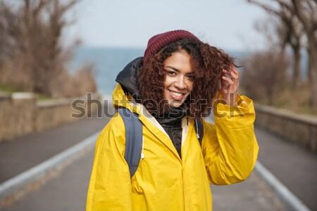 Kadın güzel kıvırcık saçlı yürüyüş şehir Stok fotoğraf © deandrobot