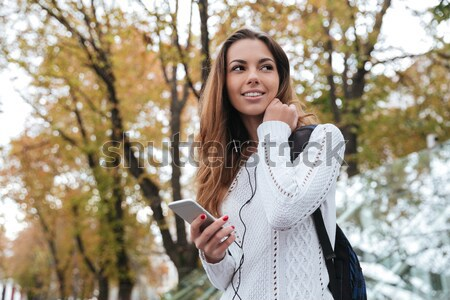 Stock photo: Portrait of a cheerful sportsgirl in earphones